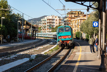 Electric Regional Train Is Arriving To Walkway Platform Of Rapallo Town, Italy