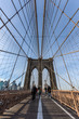 Brooklyn Bridge at sunset with people walking across in view