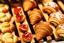 Freshly Baked Pastry On Display In Bakery Shop