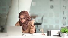 Attractive Muslin Woman Working In Office
