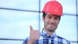 Young engineer with a smile thumbs up