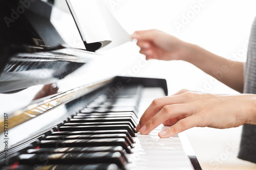 Classic piano key with musician hands playing - 257339157