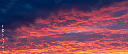 Montage in der Fensternische Hochrote Fiery red clouds, light rays and other atmospheric effect at sunset or sunrise