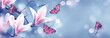 canvas print picture - Mysterious spring background with blooming pink magnolia flowers and flying butterfly. Fantasy floral banner