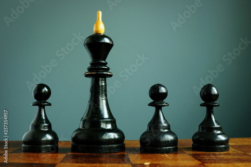 Fototapety, obrazy: Competitive edge or business advantage in recruitment. Pawns and chess king.