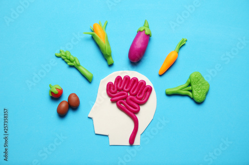 Fototapeta Plasticine figure of man and vegetarian food. Food for mind, charge of energy. Healthy lifestyle, detoxification and antioxidants. obraz