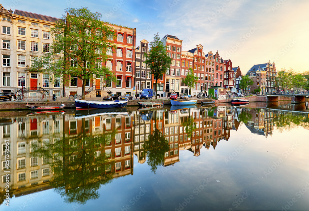 Fototapety, obrazy: Beautiful Amsterdam sunset. Typical old dutch houses on the bridge and canals in spring, Netherlands