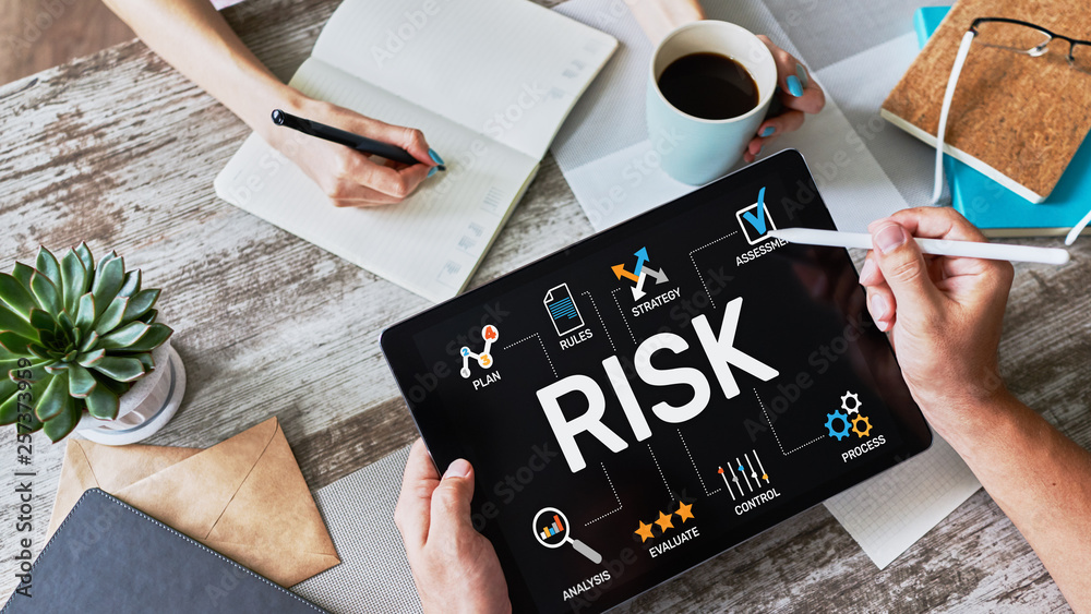 Fototapeta Risk management business and technology concept on virtual screen.