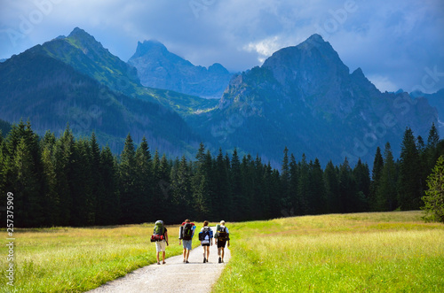 Friend hiking tohether in nature, big mountains in background. High Tatras, Slovakia