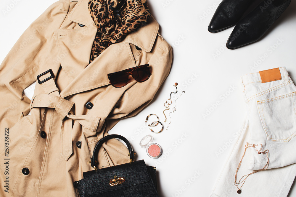 Fototapety, obrazy: Women fashion clothes and accessories flat lay, beige trench coat with bag, glasses, denim and western boots