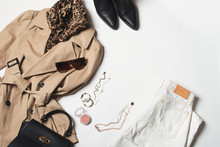 Women Fashion Clothes And Accessories Flat Lay, Beige Trench Coat With Bag, Glasses, Denim And Western Boots
