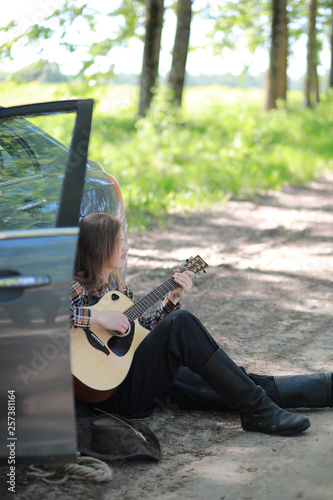 Fototapety, obrazy: A man with a guitar on summer day outdoors