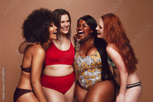 Photo Different size females in bikinis laughing together