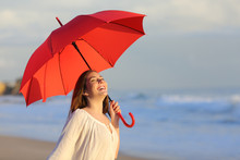 Excited Woman Holding Red Umbr...