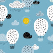 Childish seamless pattern with hot air ballon in the sky. Perfect for fabric, textile, wrapping. Cute cartoon background. Scandinavian style.