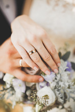 Newly Wed Couple's Hands With ...