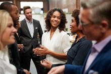 Business Team Standing Having Informal Meeting In Modern Office