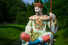 Brightly Painted Chinese Sculpture In National Clothes. Catherine Park In The City Of Pushkin.