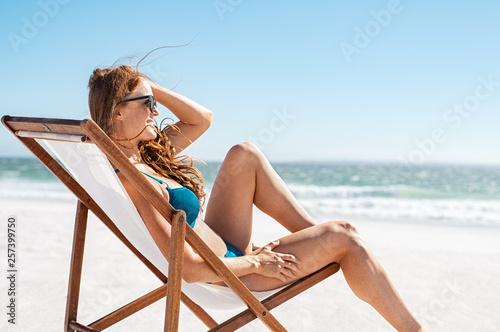 Deurstickers Ontspanning Relaxed woman sunbathing at beach