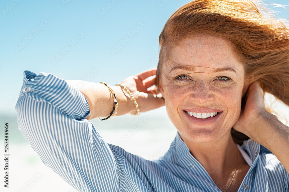 Fototapety, obrazy: Smiling mature woman at beach
