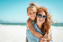 Mother With Daughter At Beach