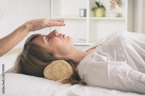 Photo  Professional Reiki healer doing reiki