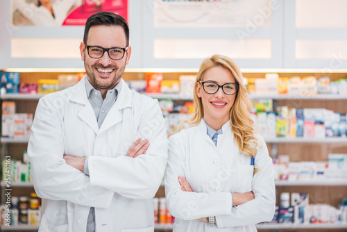 Photo sur Toile Pharmacie Portrait of a two beautiful young pharmacists at workplace.
