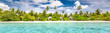 Leinwanddruck Bild - Panoramic beach landscape. Maldives island wonderful scenery, luxury beach villas and palm trees over white sand. Exotic vacation and beach holiday template banner