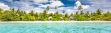 Panoramic beach landscape. Maldives island wonderful scenery, luxury beach villas and palm trees over white sand. Exotic vacation and beach holiday template banner