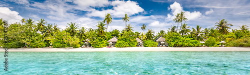 Ile Panoramic beach landscape. Maldives island wonderful scenery, luxury beach villas and palm trees over white sand. Exotic vacation and beach holiday template banner