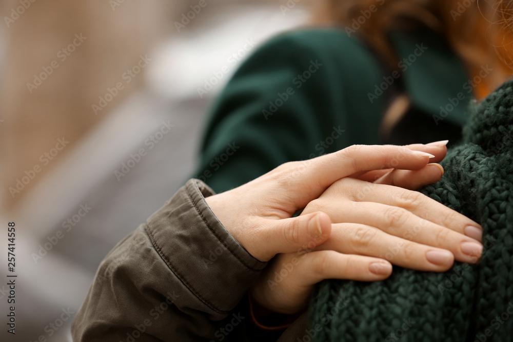 Fototapeta Young woman comforting her friend outdoors