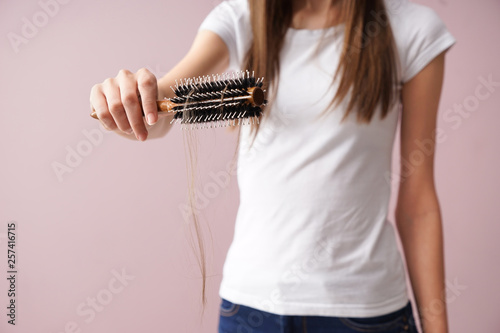 Fényképezés  Woman with hair loss problem on color background