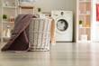 Leinwandbild Motiv Basket with laundry in room