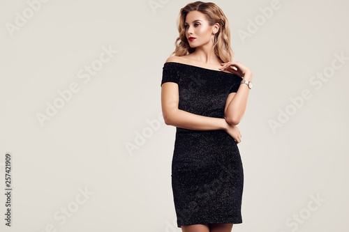 Gorgeous elegant sensual blonde woman wearing fashion black dress Fototapet