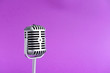 canvas print picture - Retro microphone on color background