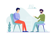 Sad Man Sitting On The Chair Talking To Male Psychologist