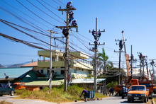 Electricians Working On A Powe...