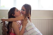 Pre Teen Caucasian Sisters Hugging