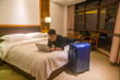 Businessman using laptop in the business travel at night