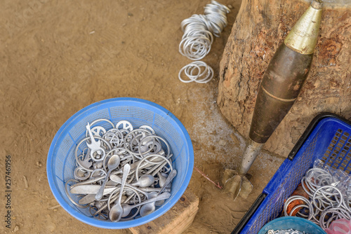 Locals in Laos make cutlery and jewellery using scrap aluminium salvaged from unexploded ordnance dropped during the U Canvas Print
