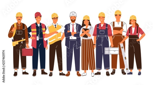 Fototapeta Group portrait of cute happy industry or construction workers, engineers standing together