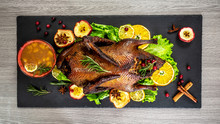 Cutting The Roast Duck And Ora...