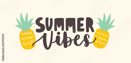 Valokuva  Summer Vibes lettering handwritten with cursive calligraphic font and decorated by pineapples