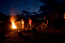Three Rock Climbers Drink A Few Beers  And Party Around A Campfire  After A Day Of Climbing In Vantage, Washington.