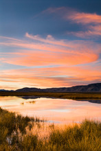 Sunset And Clouds Reflected In Eastern Sierra Pond Near Mammoth California