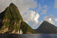 A Classic Yacht Sails Along The Coast Of St. Lucia With The Pitons In The Background.
