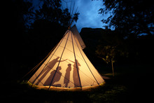 A Family At The Tipi After Sunset At Enchantment Resort In Sedona, Arizona. (releasecode: CM_MR1010, CM_MR1016, CM_MR1017, CM_MR1018, CM_MR1019)