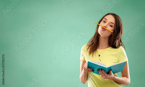 Valokuvatapetti education, school and people concept - teenage student girl in yellow t-shirt wi