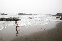 A Girl Runs In Circles On California's Northern Coast As The Fog Begins To Move In.