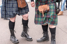 Two Bagpipers Dressed In Traditional Scottish Dress Kilt